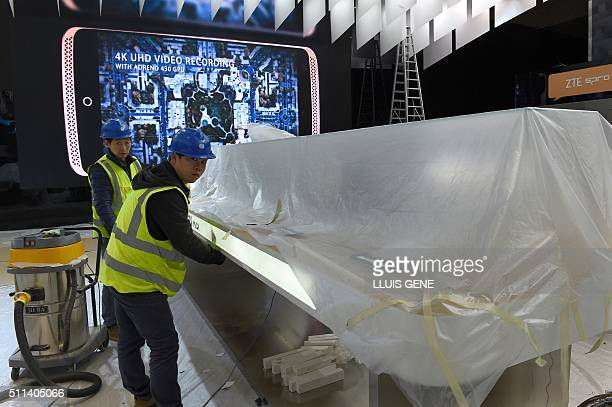 Workers prepare facilities for the Mobile World Congress in Barcelona on February 20 before the start of the world's biggest mobile fair held from...