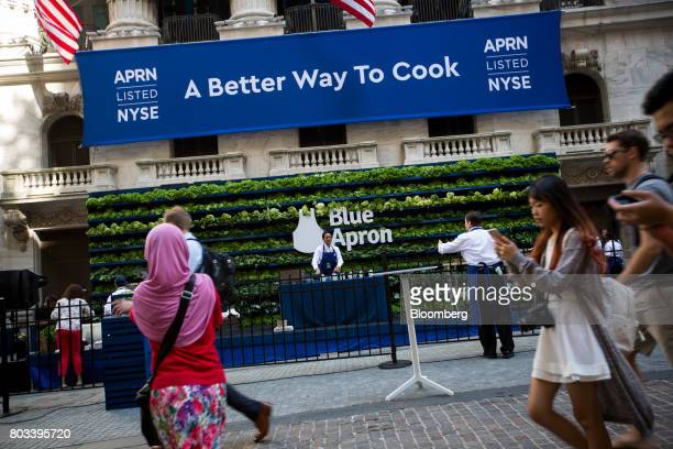Workers prepare for a Blue Apron Holdings Inc event before the company's initial public offering outside the New York Stock Exchange in New York US...