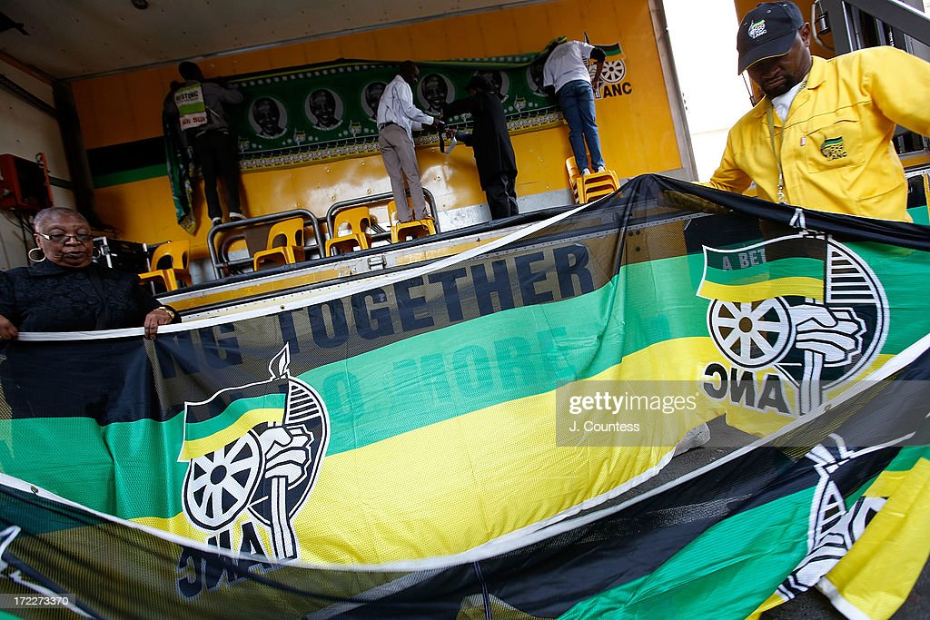 ANC workers prepare for an African National Congress-sponsored prayer rally outside ANC headquarters on July 2, 2013 in Johannesburg, South Africa. The anti-apartheid icon and Nobel Peace Prize Laureate has been in the hospital for more than three weeks being treated for a recurring lung infection.