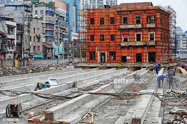 Workers prepare for the monolithic movement of a historic site in Changdi Street on March 9 2016 in Wuhan Hubei Province of China The historical site...