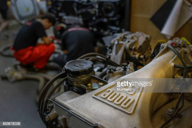 Workers prepare for V6 3000 engine install at mohenic garages in Paju South Korea A 20yearold beat up Hyundai SUV isn't anyone's idea of a dream car...