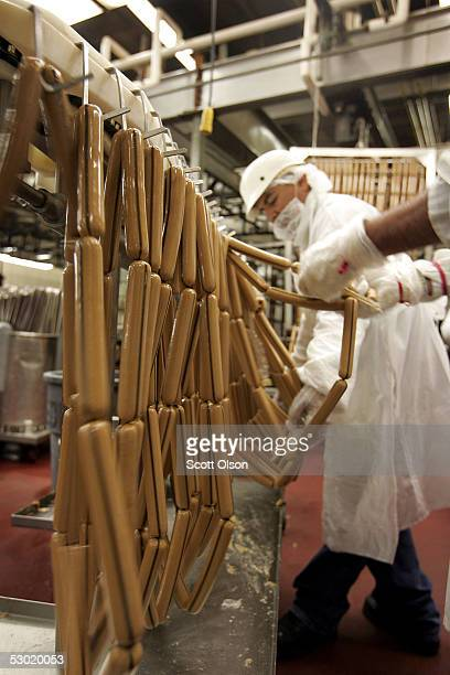 Workers prepare hot dogs for cooking at the Vienna Beef factory June 4 2005 in Chicago Illinois Vienna Beef recently signed a deal with Target Corp...