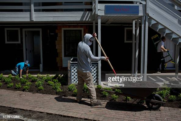 Workers prepare landscaping at Baron's Cove Hotel and Restaurant for the reopening ahead of Memorial Day weekend in Sag Harbor US on Monday May 11...