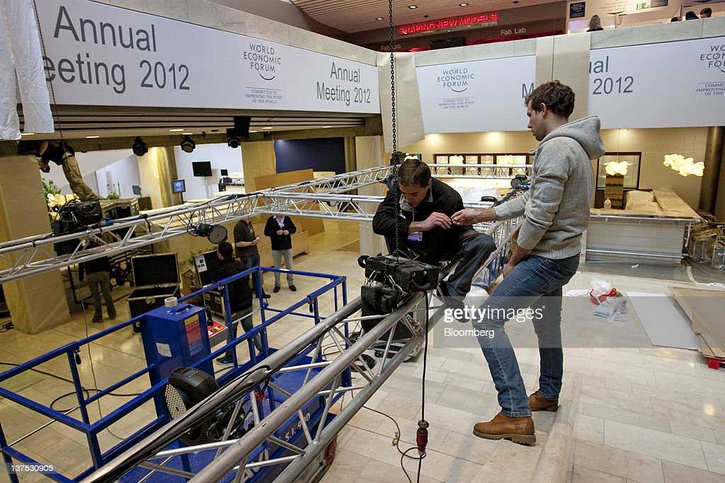 Workers prepare lighting equipment inside the Congress Centre, the venue of the World Economic Forum's (WEF) 2012 annual meeting, in the town of Davos, Switzerland, on Sunday, Jan. 22, 2012. German Chancellor Angela Merkel will open next week's World Economic Forum in Davos, Switzerland, which will be attended by policy makers and business leaders including U.S. Treasury Secretary Timothy F. Geithner. Photographer: Scott Eells/Bloomberg via Getty Images