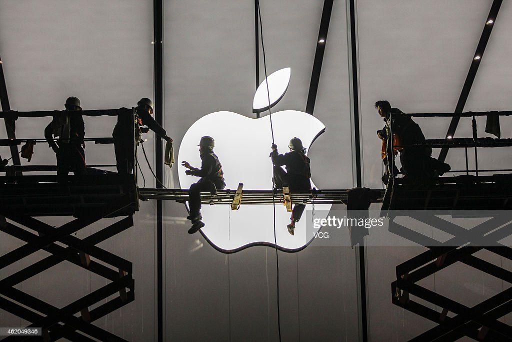 Workers prepare outside the largest Apple Store in Asia for its opening on January 23 2015 in Hangzhou Zhejiang province of China The Apple Store...