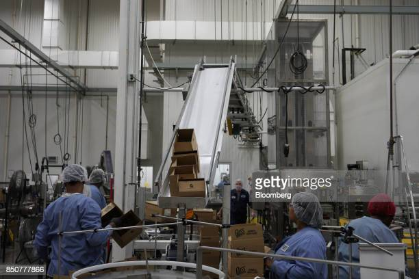 Workers prepare products for shipment at the Tulkoff Food Products Inc factory in Baltimore Maryland US on Tuesday Aug 29 2017 While economists have...