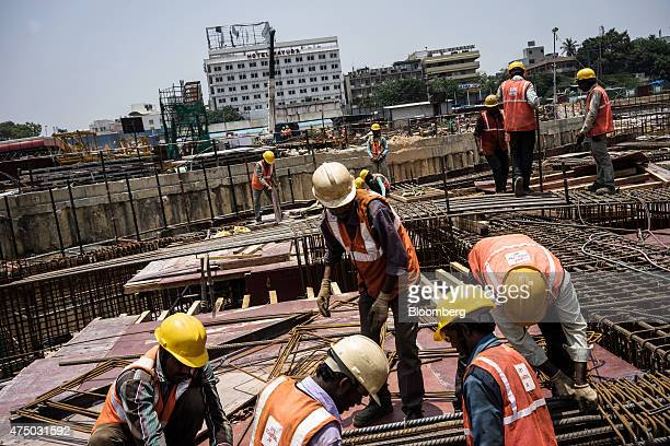 Workers prepare reinforcing steel at the construction site of Majestic metro station developed by Bangalore Metro Rail Corp in Bengaluru India on...
