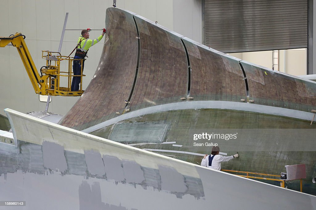 Workers prepare rotor blades for wind turbines at the Enercon wind turbine factory on January 4, 2013 in Aurich, Germany. Germany is invetsing heavily in alternative energy sources and has set a high priority on onshore and offshore wind farms.