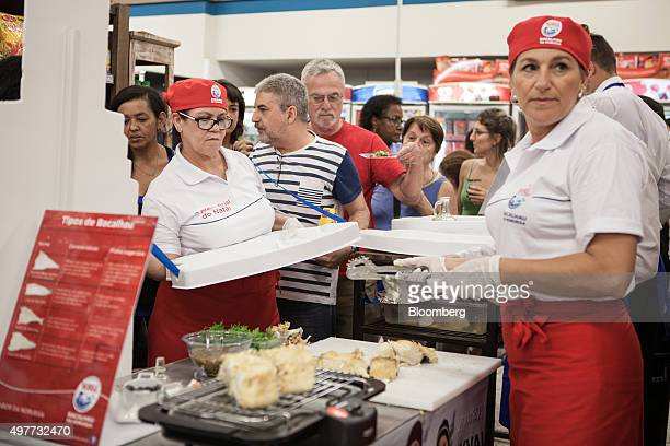 Workers prepare samples of Norwegian cod for shoppers at a supermarket in Rio de Janeiro Brazil on Tuesday Nov 17 2015 Cod export volumes from Norway...