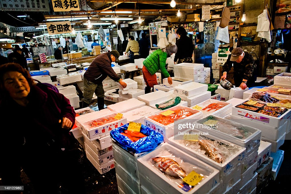 Workers prepare seafood for sale at the Tsukiji fish market on February 28 2012 in Tokyo Japan Tsukiji fish market is the biggest wholesale fish and...
