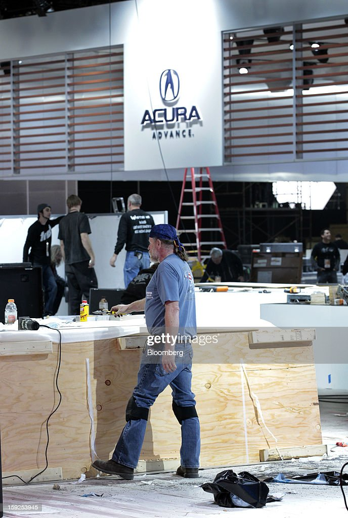 Workers prepare the Acura exhibit during an advance tour of the North American International Auto Show (NAIAS) at Cobo Hall in Detroit, Michigan, U.S., on Thursday, Jan. 10, 2013. More than 23,000 attendees representing almost 2,000 companies are expected to attend the industry preview for NAIAS on Jan. 16-17. The general public can attend the show from Jan. 19-27. Photographer: Jeff Kowalsky/Bloomberg via Getty Images