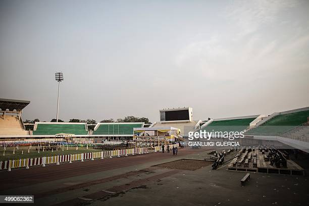Workers prepare the Barthelemy Boganda stadium where Pope Francis will attend a mass in Bangui on the eve of his arrival to the Central African...