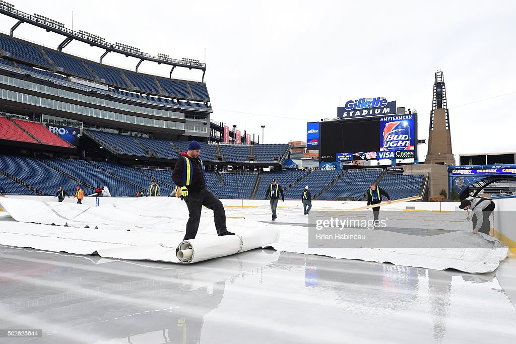 http://media.gettyimages.com/photos/workers-prepare-the-field-for-the-2016-nhl-bridgestone-winter-classic-picture-id502625644