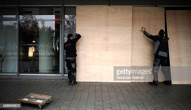 Workers prepare the glass facade of the Novotel Hotel at Hanover Central Trainstation with timber to prevent damages on November 14 2014 in Hanover...