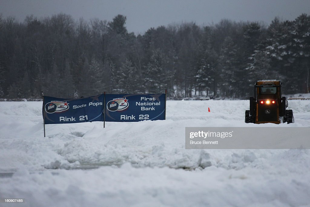 Workers prepare the ice surface for the 2013 USA Hockey Pond Hockey National Championships on February 7, 2013 in Eagle River, Wisconsin. The three-day tournament will feature 2,400 participants from 30 states playing a round robin tournament on 28 rinks laid out on Dollar Lake.