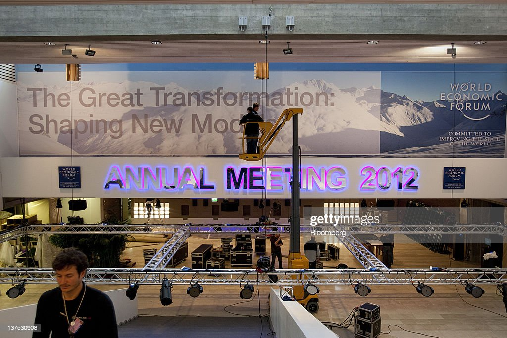 Workers prepare the inside the Congress Centre, the venue of the World Economic Forum's (WEF) 2012 annual meeting, in the town of Davos, Switzerland, on Sunday, Jan. 22, 2012. German Chancellor Angela Merkel will open next week's World Economic Forum in Davos, Switzerland, which will be attended by policy makers and business leaders including U.S. Treasury Secretary Timothy F. Geithner. Photographer: Scott Eells/Bloomberg via Getty Images