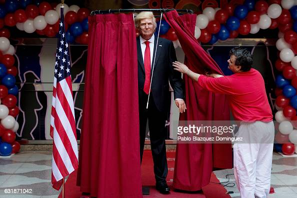 Workers prepare the presentation of US Presidentelect Donald Trump wax figure before a FEMEN activist interrupted the event outside Madrid Wax Museum...