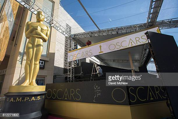 Workers prepare the red carpet arrival area on Hollywood Boulevard for the 88th Annual Academy Awards at Hollywood Highland Center on February 25...