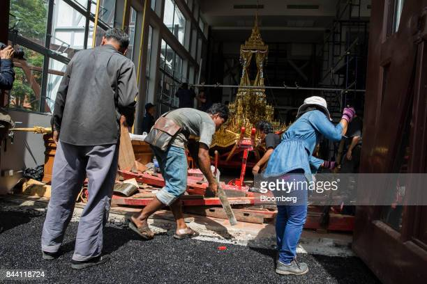 Workers prepare the royal funeral chariot for the cremation ceremony of King Bhumibol Adulyadej at the Bangkok National Museum in Bangkok Thailand on...