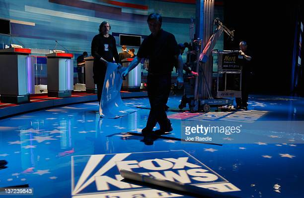 Workers prepare the stage for the Fox News/Wall Street Journal/South Carolina GOP debate at the Sheraton Myrtle Beach Convention Center on January 16...