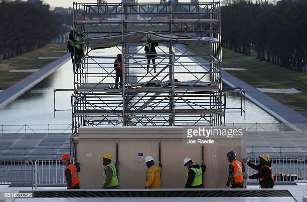 Workers prepare the stage in front of the Lincoln Memorial to be used in the presidential inauguration festivities for President elect Donald Trump...
