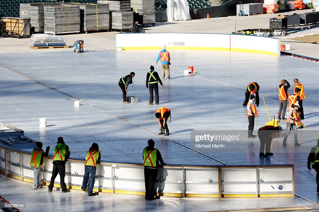 Workers prepare the surface before putting down the ice as part of the 2016 Coors Light Stadium Series at Coors Field on February 12, 2016 in Denver, Colorado. The game is scheduled to be played on Feb 27.