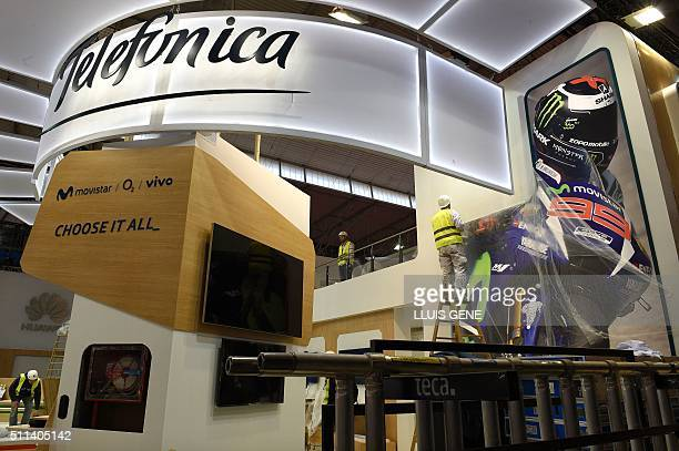 Workers prepare the Telefonica stand facilities for the Mobile World Congress in Barcelona on February 20 before the start of the world's biggest...