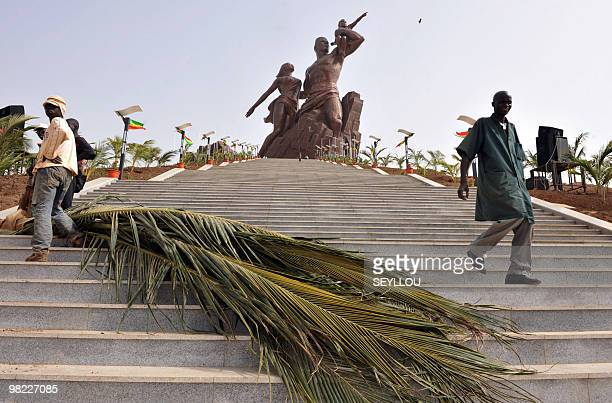 Workers prepare the unveiling of the 'African Renaissance Monument' on April 2 2010 in Dakar for the April 3 inauguration where some 30 heads of...