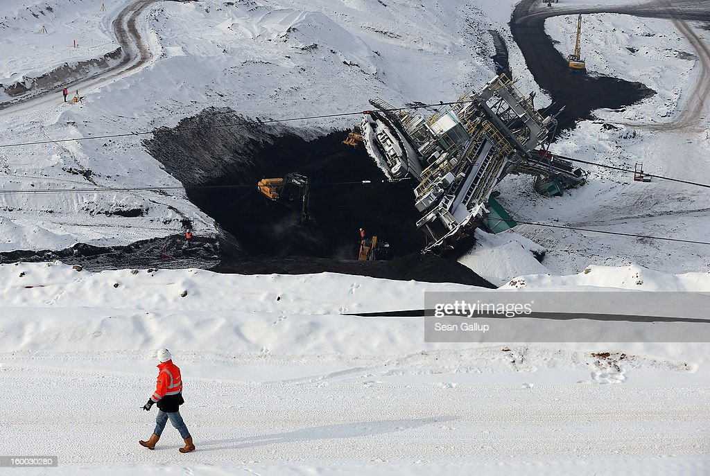 Workers prepare to attempt to set a 950-tonne bucket excavator upright following an accident at an open-pit coal mine on January 25, 2013 near Deutzen, Germany. The bucket excavator tipped over last summer after plateaus of clay and sand nearby gave way, pushing a layer of coal underneath. The excavator had been lying severely tilted to one side ever since at the Vereinigtes Schleenhain mine, which is operated by Mibrag. Open-pit lignite coal mines are still common across eastern Germany and produce coal for local electricity production.