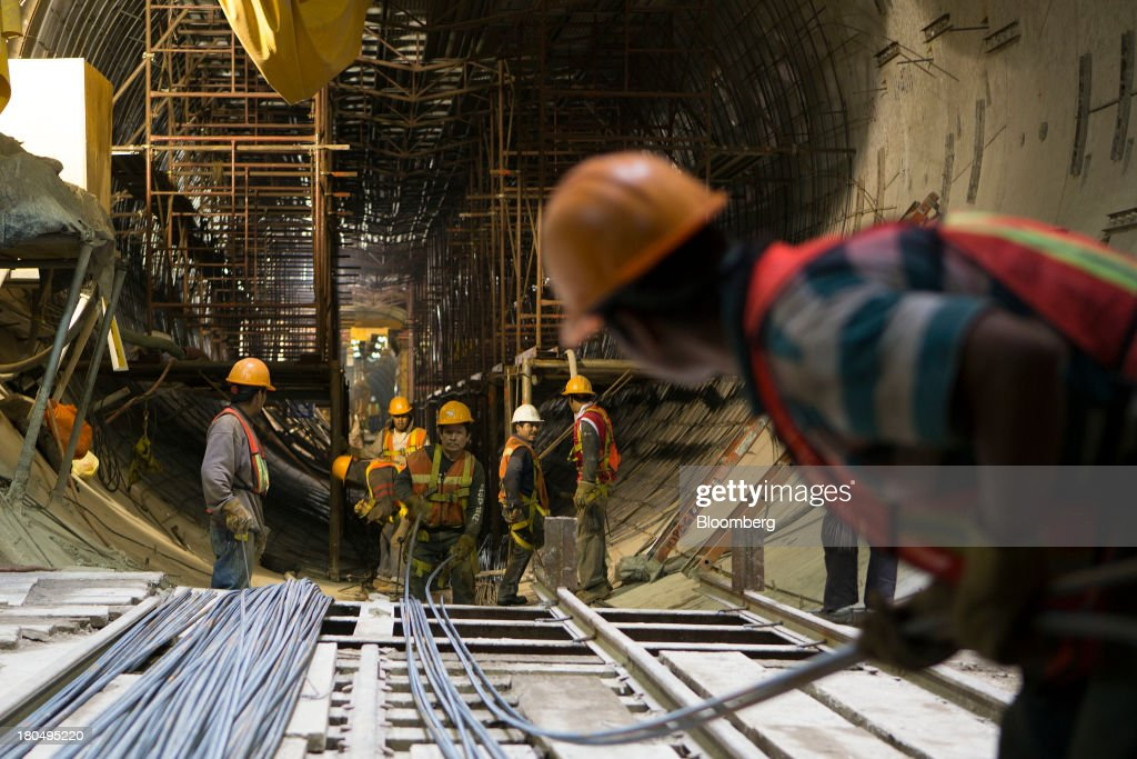 Workers prepare to carry steel rods inside the Tunnel Emisor Oriente (TEO), or Eastern Discharge Tunnel, during construction of the 38 mile (62km) underground wastewater treatment tunnel in Mexico City, Mexico, on Thursday, Sept. 12, 2013. The tunnel, which is expected to be completed in 2014, will boost Mexico City's drainage capacity to help prevent flooding during rainy season and the over-exploitation of groundwater resources. The project is being managed by Mexico's National Water Commission, Conagua. Photographer: Susana Gonzalez/Bloomberg via Getty Images