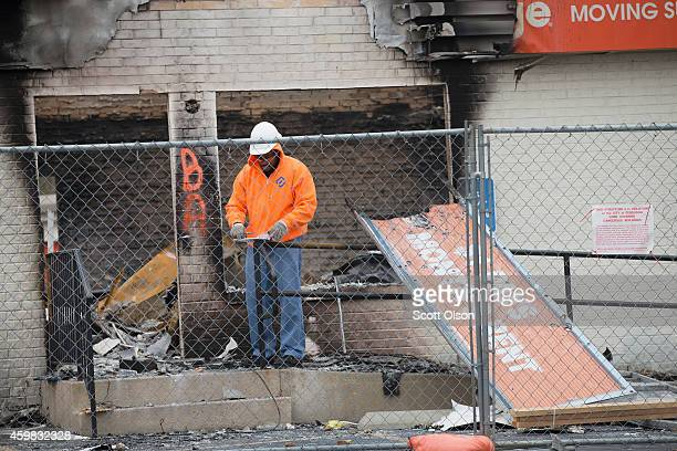 Workers prepare to demolish a building that was burned during last weeks riot on December 2 2014 in Ferguson Missouri Ferguson has experienced...
