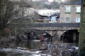Workers prepare to demolish the 200 year old Waterside Pub at Summerseat in Greater Manchester which collapsed during the boxing floods on December...