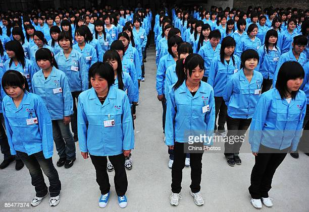 Workers prepare to depart for a factory at the Shenzhen Quanshun Human Resources Co Ltd on February 26 2009 in Shenzhen Guangdong Province China The...