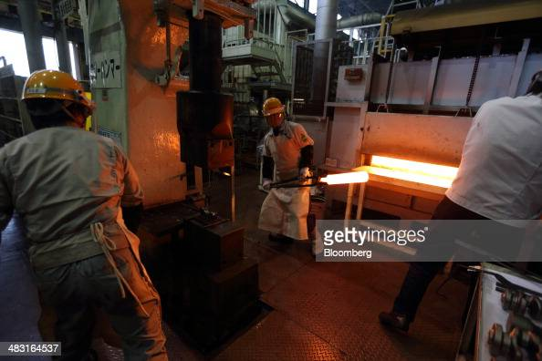 Workers prepare to forge an automobile part in the forging department at a Toyota Motor Corp plant in Toyota City Aichi Prefecture Japan on Tuesday...