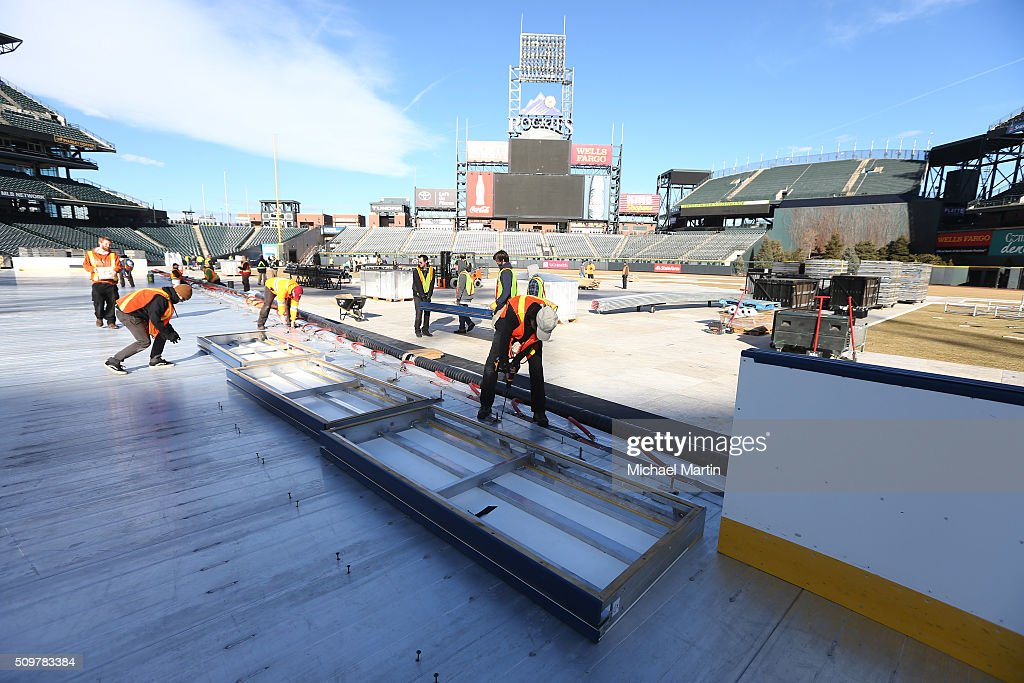Workers prepare to install the boards as part of the rink build out for the 2016 Coors Light Stadium Series at Coors Field on February 12, 2016 in Denver, Colorado. The game is scheduled to be played on Feb 27.
