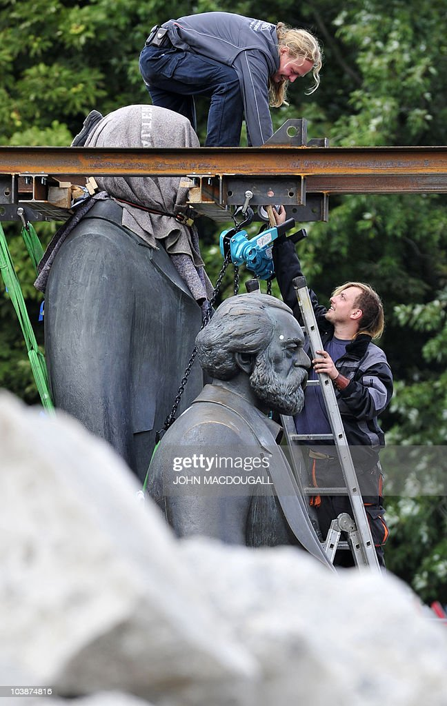 Workers prepare to lift a statue of German political philosopher Friedrich Engels (L) off of its base separating it from a statue of Karl Marx, in Berlin September 7, 2010. The two statues are being moved, one by one to allow for work on the new U55 underground line. They were made by east German sculptor Ludwig Engelhardt and inaugurated in 1986 by then Communist supremo Erich Honecker.