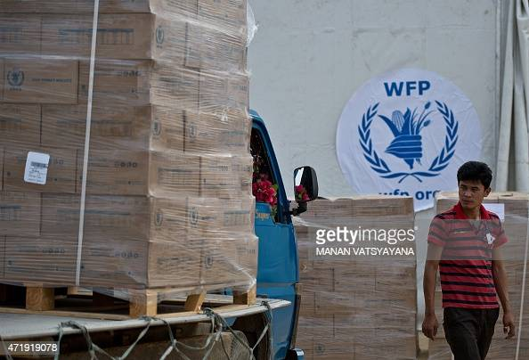 Workers prepare to offload food packets to be distributed by the World Food Program to earthquake affected areas at the Relief Dispatch hub in...