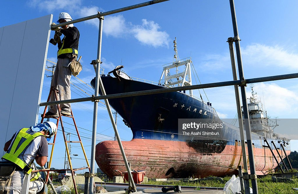 Workers prepare to take apart the Dai 18 Kyotoku Maru, 330-ton fishing boat washed away 750 metres inland by the towering tsunami after the magnitude 9.0 earthquake in 2011, on September 9, 2013 in Kesennuma, Miyagi, Japan. The unusual sight of the fishing boat became a symbol across the world of the power and devastation of the Great East Japan Earthquake.