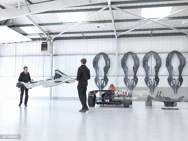 Workers preparing supercar in sports car factory