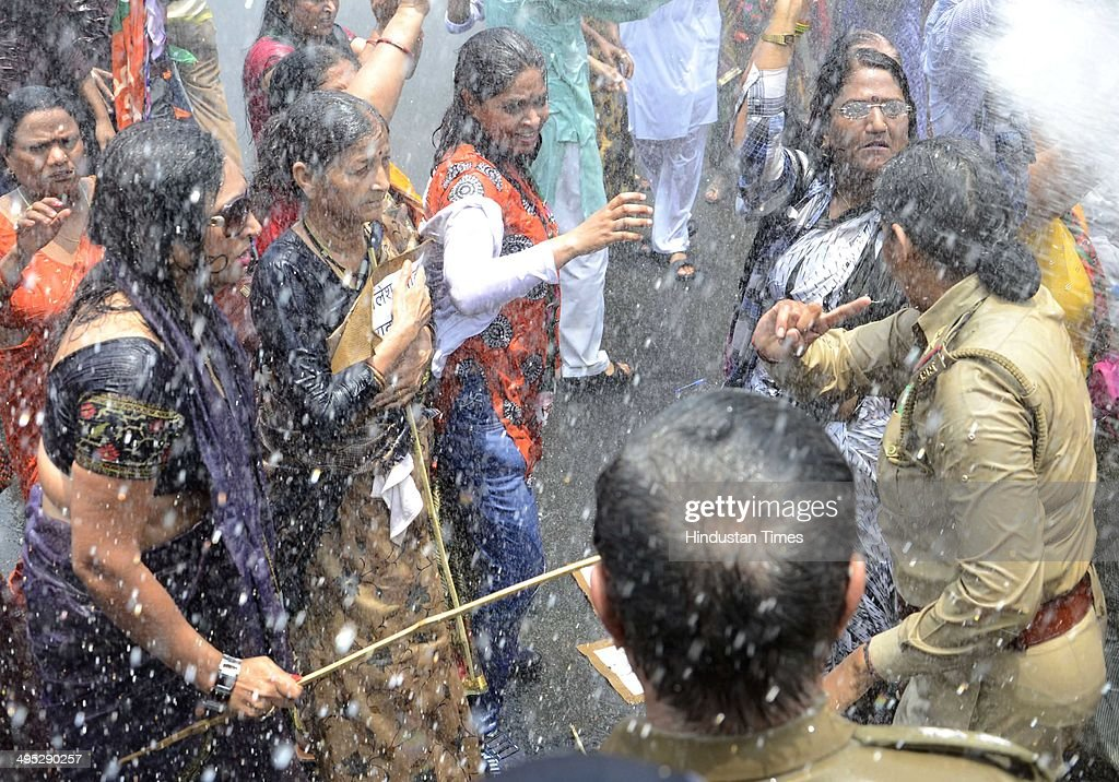 BJP workers protest against state goverment outside Uttar Pradesh Chief Minister Akhilesh Yadav's office, slamming the poor law and order situation in the state in view of the horrific Badaun gang-rape case, on June 2, 2014 in Lucknow, India. Uttar Pradesh police used water cannons on the BJP workers. Two of the men arrested for allegedly raping and murdering two cousins whose bodies were found hanging from a tree in Badaun district, Uttar Pradesh, have confessed to the crime, police said on Sunday. Police have arrested five main accused, including two policemen, in connection with the crime in Katra village. Two unidentified accused are absconding.