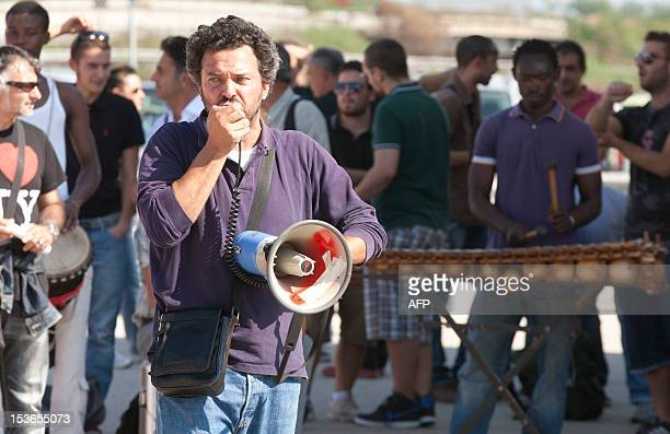 Workers protest on October 8 2012 against their temporary dismissal in Pomigliano D'Arco near Naples Fiat agreed in July to move production of its...