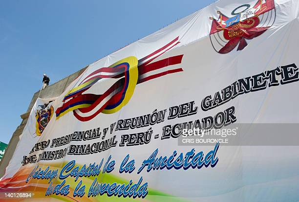 Workers pull up a gigantic banner on February 28 in a main street of the city of Chiclayo 760 km north of Lima announcing the Presidential Encounter...