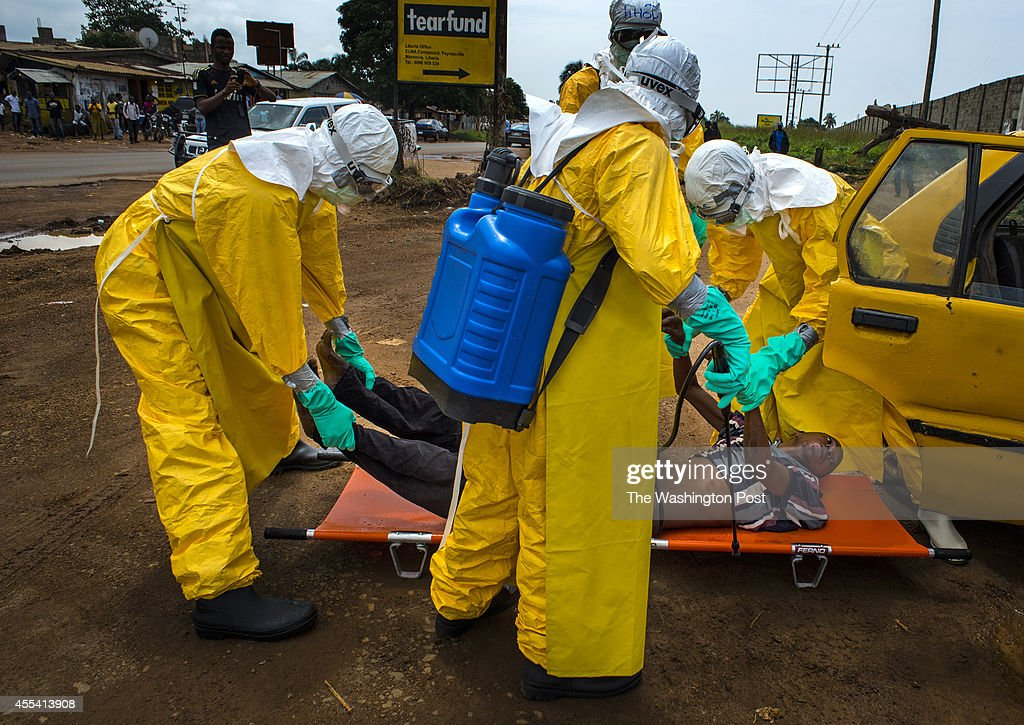 workers put a man on a stretcher after he arrived at the treatment facility in the back seat of a taxi on Saturday September 13 2014 in Monrovia...