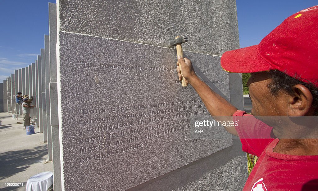 Workers put finishing touches before the opening of Santuario de la Esperanza (Sanctuary of Hope) similar to the Mayan steles, during preparations for the celebration of the end of the Maya Long Count Calendar --Baktun 13-- and the beginnig of a new era on December 18, 2012 in Cancun, Quintana Roo state, Mexico. AFP HOTO/Pedro Pardo
