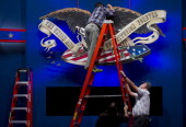 Workers put finishing touches on the stage a day ahead of the final presidential debate to be held at the Wold Performing Arts Center at Lynn...