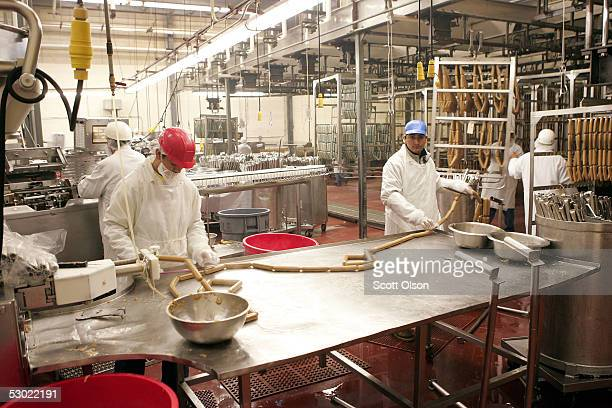 Workers put hot dog ingredients into casings at the Vienna Beef factory June 4 2005 in Chicago Illinois Vienna Beef recently signed a deal with...