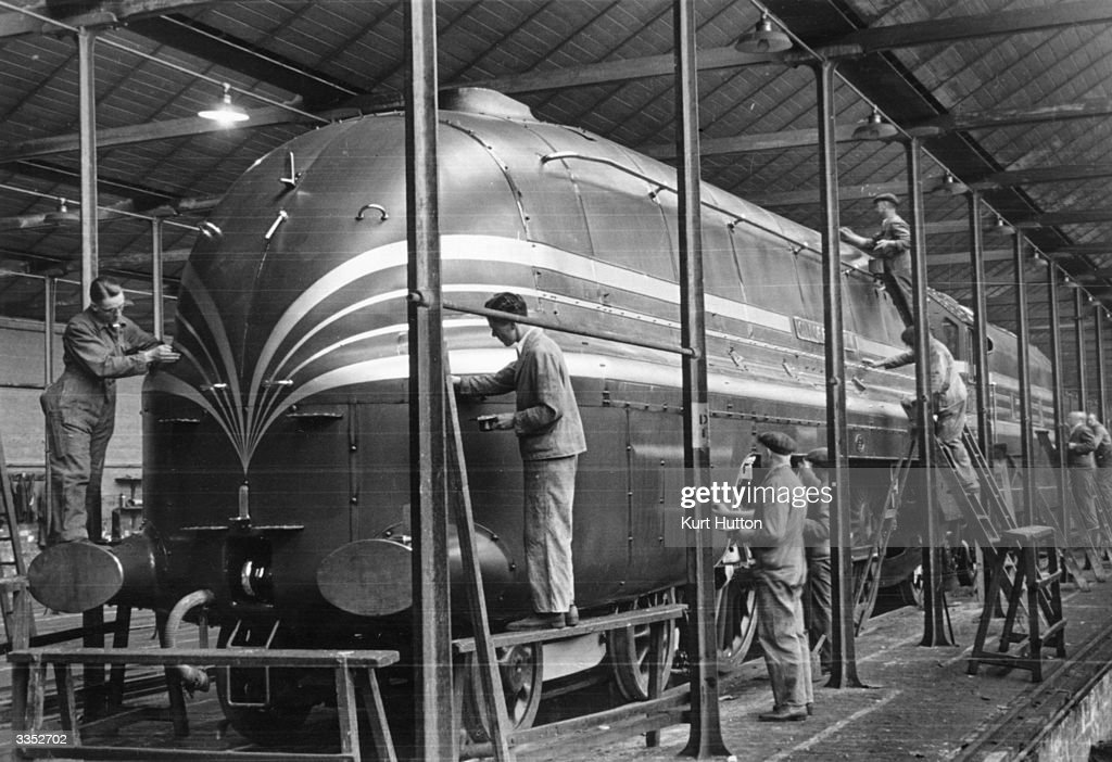 Workers put the finishing touches to a locomotive in the paintshop at Crewe railway works Original Publication Picture Post 393 Making Of A Steam...