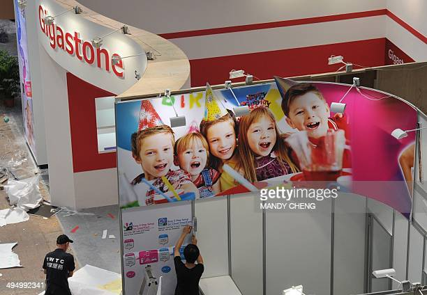 Workers put the finishing touches to booths at the Taipei World Trade Centre the venue of the annual Computex Asia's leading IT trade fair in Taipei...