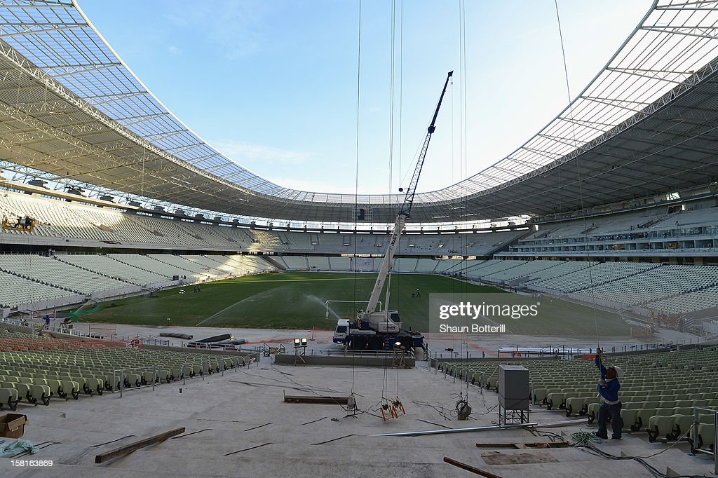 Workers put the finishing touches to the Arena Castelao venue for the FIFA 2014 World Cup on December 10, 2012 in Fortaleza, Brazil.