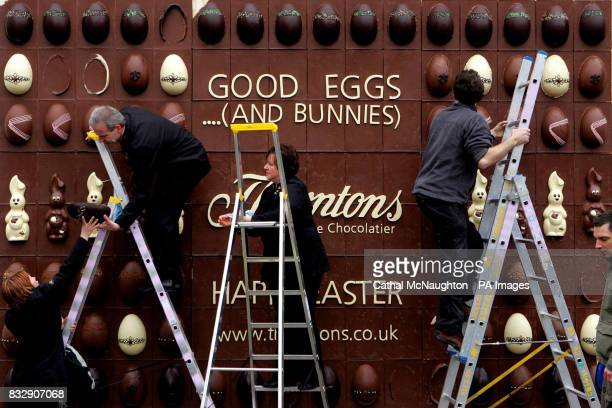 Workers put the finishing touches to the worlds first edible chocolate billboard at Covent Garden central London